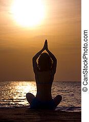 Asana Sukhasana - Silhouette of serene young woman...