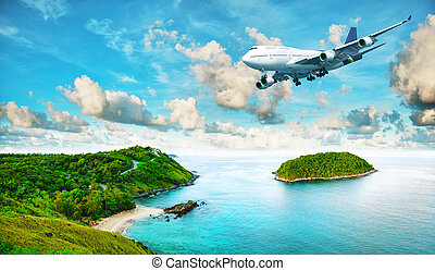 Jet plane over the tropical island. Panoramic composition in...