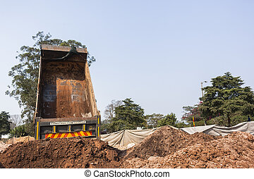 Truck Earthworks - Construction truck vehicle tipping raw...