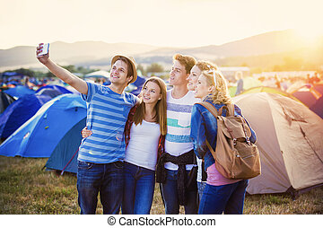 Teens at summer festival - Group of beautiful teens at...