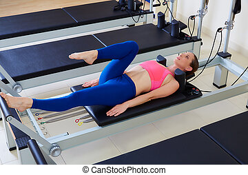 Pilates reformer woman foot work exercise workout at gym...