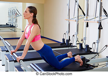 Pilates reformer woman down stretch exercise workout at gym...
