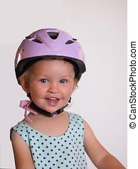 Smiling girl in a bicycle helmet