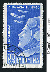 postmark - ROMANIA - CIRCA 1960: The military pilot looks in...