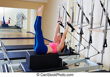 Pilates reformer woman back stroke exercise workout at gym...