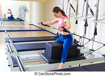 Pilates reformer woman short box horse back exercise workout...