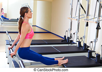 Pilates reformer woman tendon stretch exercise workout at...
