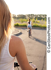 Young woman on bicycle on road