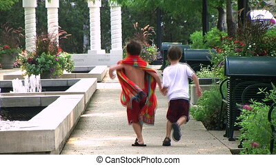 Boys Skipping in Park - Boys skipping in park on breezy...
