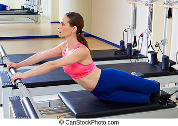 Pilates reformer woman mermaid exercise workout at gym