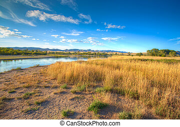 Sunset over the Missouri Headwaters State Park. - Vivid...