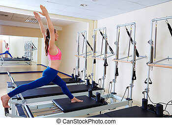 Pilates reformer woman russian split exercise workout at gym...