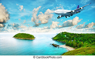 Jet liner over the tropical island. Panoramic composition in...