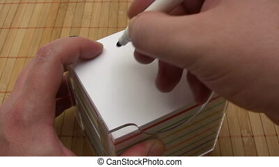 Writing a Contact Us Note - Writing the words CONTACT US on...