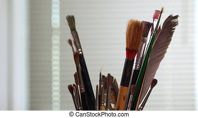 Paint brushes turning - in the pot all kinds of brushes