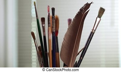 Paint brushes turning - Artist pick up a brush