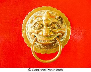 Chinese door knob on red door background