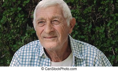 senior man portrait - portrait of a senior man outdoor