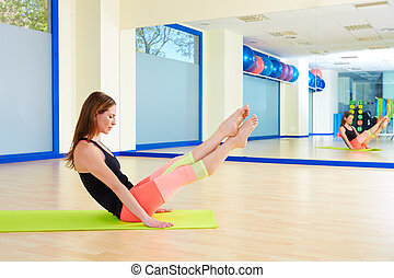 Pilates woman boomerang exercise workout at gym indoor
