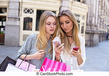 young women - young woman using her friends phone