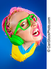 grimace - Crazy expressive trendy DJ girl in bright clothes,...