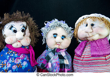 Cute dolls - 3 nostalgic dolls isolated with black...