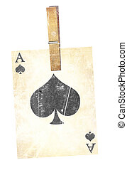 playing card - old playing card with wooden clothes peg
