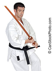 karate expert with wooden sword