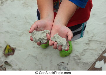 outstretched hands of a child - a child in the hands of the...