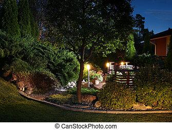 Garden lights illumination - Illuminated home garden evening...