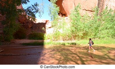 Woman Hiker Backpacker near Jacob Hamblin Arch Coyote Gulch...
