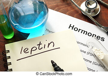 leptin - Hormone leptin written on notebook Test tubes and...
