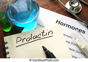 prolactin - Hormone prolactin written on notebook. Test...