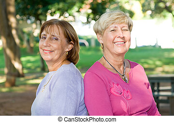 old people, young hearts - portrait of two senior caucasian...