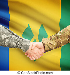 Men in uniform shaking hands with flag on background - Saint...