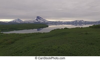 Volcano and lake in Russia on Kamchatka