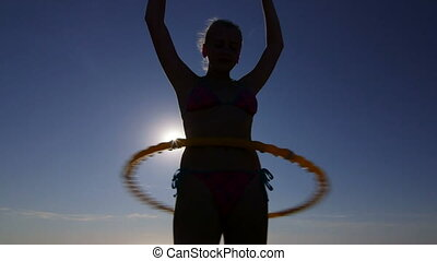 girl with massage hula hoop - Young girl with massage hula...