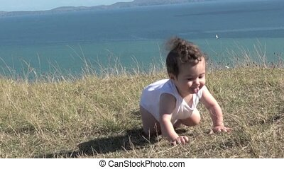 Slow motion Baby girl crawling outdoors Baby development...