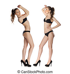Full length portrait of a beautiful young models in black...