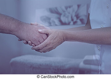 Therapist welcoming new patient - Female therapist holding...