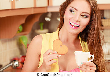 Girl with tea coffee eating gingerbread cookie - Pretty pin...