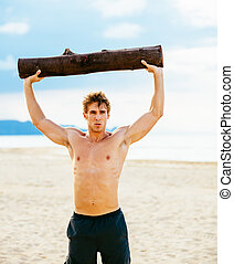 Male Athlete Exercising Outdoors - Crossfit beach workout....