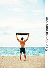 Male Athlete Exercising Outdoors - Crossfit beach workout...