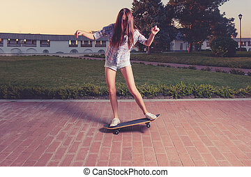 Women riding skateboard toned image