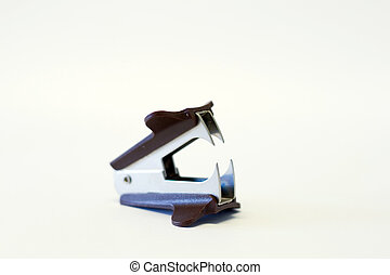 staple remover on isolated white background