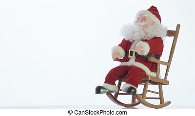 Santa Claus in Christmas - Santa Claus toy rocking in a...