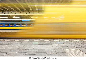 Departing train - Train departing from a platform, leaving a...