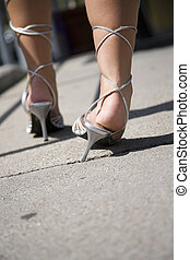 heels - woman twists her ancle