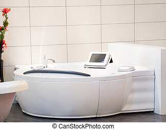 Jacuzzi Spa Bathtub with computer screen in a marble...