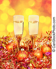 glasses, gold Xmass balls on blurry background 2 - Christmas...